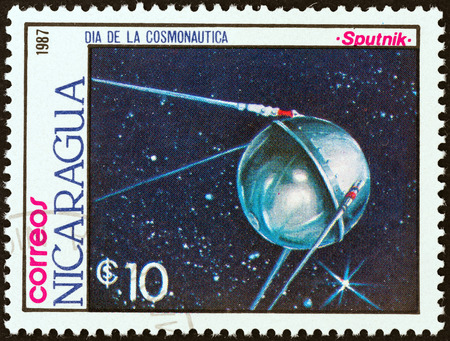 timbre: NICARAGUA - CIRCA 1987: A stamp printed in Nicaragua from the \Cosmonautics Day \ issue shows Sputnik satellite, circa 1987.