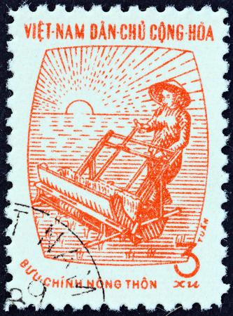 estampilla: NORTH VIETNAM - CIRCA 1962: A stamp printed in North Vietnam shows woman with rice planter, circa 1962.