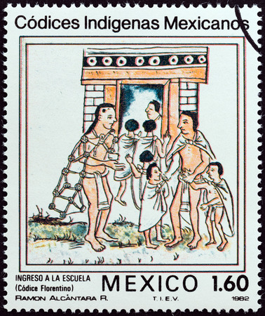 codex: MEXICO - CIRCA 1982: A stamp printed in Mexico from the Native Mexican Codices - Florentine Codex  issue shows Admission to School, circa 1982.