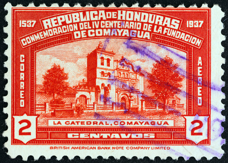 foundation problems: HONDURAS - CIRCA 1937: A stamp printed in Honduras from the \400th anniversary of Comayagua \ issue shows Comayagua Cathedral, circa 1937.