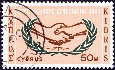 stempel: CYPRUS - CIRCA 1965: A stamp printed in Cyprus issued for the International Co-operation Year shows I.C.Y. Emblem, circa 1965. Editorial