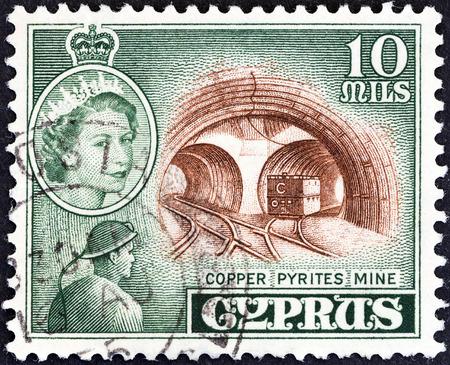 kibris: CYPRUS - CIRCA 1955: A stamp printed in Cyprus shows Mavrovouni Copper Pyrites Mine and Queen Elizabeth II, circa 1955.
