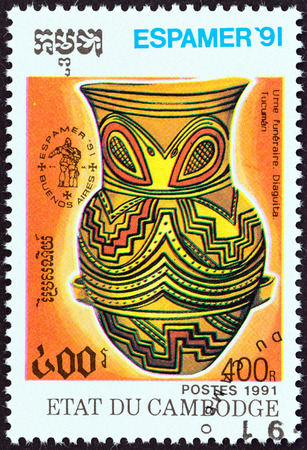 pre columbian: CAMBODIA - CIRCA 1991: A stamp printed in Cambodia from the Espamer 91, Iberia Latin America Stamp Exhibition, Buenos Aires  issue shows Diaguita funerary urn, Tucuman, circa 1991. Editorial