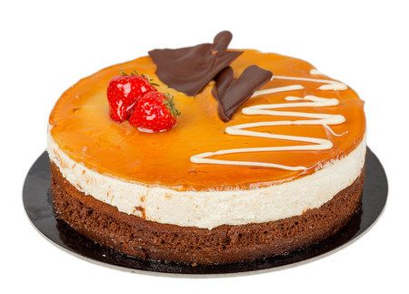 Chocolate cake with caramel on top isolated photo