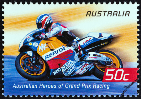repsol honda: AUSTRALIA - CIRCA 2004: A stamp printed in Australia from the Australian Heroes of Grand Prix Racing  issue shows Mick Doohan (Repsol Honda), circa 2004.