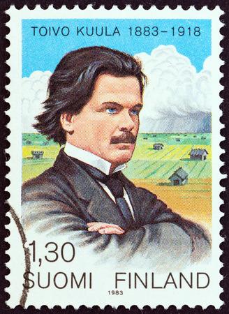 estampilla: FINLAND - CIRCA 1983: A stamp printed in Finland issued for the birth centenary of Toivo Kuula shows composer Toivo Kuula and Ostrobothnia, circa 1983. Editorial