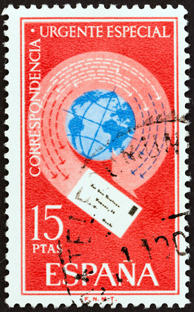 encircling: SPAIN - CIRCA 1971: A stamp printed in Spain from the \Express Stamps \ issue shows Letter encircling globe, circa 1971.