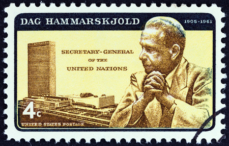un used: USA - CIRCA 1962: A stamp printed in USA shows Dag Hammarskjold and U.N. Headquarters, circa 1962. Editorial