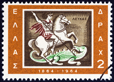 GREECE - CIRCA 1964: A stamp printed in Greece from the Centenary of Union of Ionian Islands with Greece issue shows St. George slaying dragon emblem of Lefkada, circa 1964. Editorial