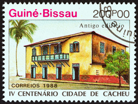 GUINEA-BISSAU - CIRCA 1989: A stamp printed in Guinea-Bissau from the 400th Anniversary of Cacheu  issue shows early building, circa 1989.