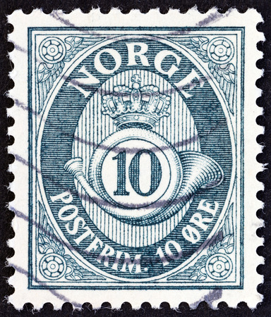 posthorn: NORWAY - CIRCA 1951: A stamp printed in Norway shows crown, post horn and value, circa 1951.