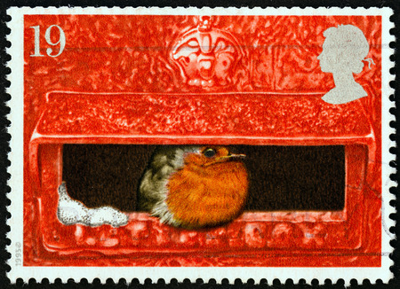 UNITED KINGDOM - CIRCA 1995: A stamp printed in United Kingdom from the Christmas issue shows European Robin in Mouth of Pillar Box, circa 1995.