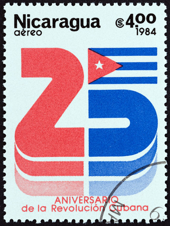 sello: NICARAGUA - CIRCA 1984: A stamp printed in Nicaragua issued for the 25th anniversary of Cuban Revolution shows number 25 and the Cuban Flag, circa 1984.