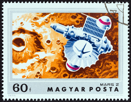 magyar: HUNGARY - CIRCA 1974: A stamp printed in Hungary from the \Mars Exploration \ issue shows Mars 2 approaching Mars, circa 1974.