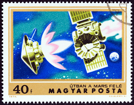 magyar posta: HUNGARY - CIRCA 1974: A stamp printed in Hungary from the \Mars Exploration \ issue shows Mariner 4 on course for Mars, circa 1974.