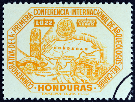 archaeologists: HONDURAS - CIRCA 1947: A stamp printed in Honduras from the \1st International Conference of Caribbean Archaeologists \ issue shows map of Honduras and Copan antiquities, circa 1947.