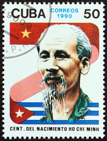 CUBA - CIRCA 1990: A stamp printed in Cuba issued for the birth centenary of Vietnamese leader Ho Chi Minh shows flags and Ho Chi Minh, circa 1990.