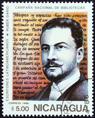 sarmiento: NICARAGUA - CIRCA 1986: A stamp printed in Nicaragua from the \National Libraries. Latin American Writers \ issue shows Ruben Dario (1867-1916), circa 1986.