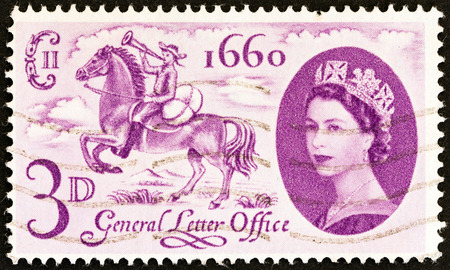 posthorn: UNITED KINGDOM - CIRCA 1960: A stamp printed in United Kingdom issued for the 300th anniversary of establishment of General Letter Office shows postboy of 1660 and Queen Elizabeth II, circa 1960. Editorial