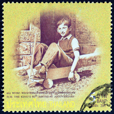 bhumibol: THAILAND - CIRCA 2007: A stamp printed in Thailand from the 80th anniversary of the Birth of H.M. The King  issue shows Thai King Bhumibol Adulyadej photograph in child age playing, circa 2007.