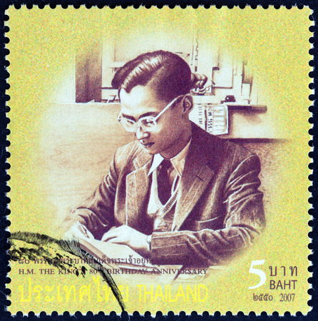 bhumibol: THAILAND - CIRCA 2007: A stamp printed in Thailand from the 80th anniversary of the Birth of H.M. The King  issue shows Thai King Bhumibol Adulyadej photograph in young age, circa 2007.