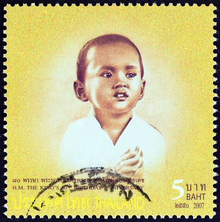 bhumibol: THAILAND - CIRCA 2007: A stamp printed in Thailand from the 80th anniversary of the Birth of H.M. The King  issue shows Thai King Bhumibol Adulyadej photograph in child age, circa 2007. Editorial