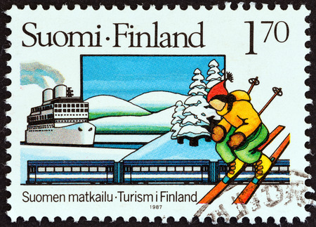 diesel train: FINLAND - CIRCA 1987: A stamp printed in Finland from the Tourism  issue shows Borea (liner), Diesel Train, Snow Scene and Skier, circa 1987.