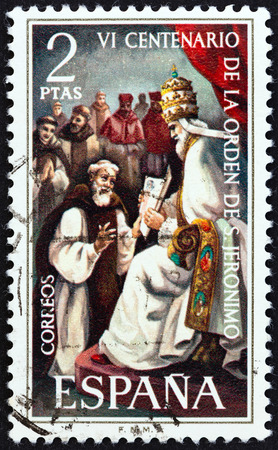 orden: SPAIN - CIRCA 1973: A stamp printed in Spain issued for the 600th anniversary of the founding of the order of St. Jerome shows Pope Gregory XI receiving St. Jerome Editorial