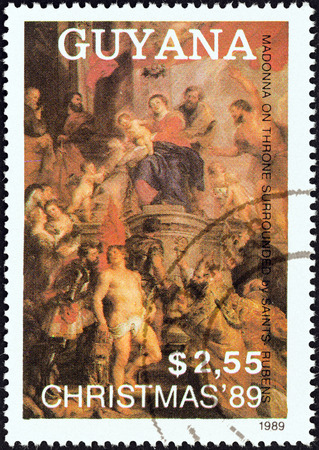 enthroned: GUYANA - CIRCA 1989: A stamp printed in Guyana from the Christmas. Paintings issue shows Madonna Enthroned, surrounded by Saints (Rubens), circa 1989.