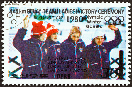 placid: NORTH KOREA - CIRCA 1979: A stamp printed in North Korea from the Winter Olympic Games, Lake Placid  issue shows women 4x5 relay team victory ceremony, circa 1979.