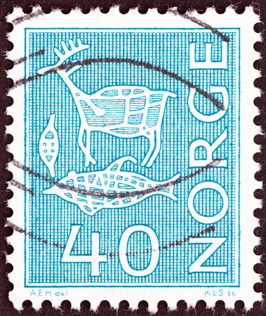 fish animal: NORWAY - CIRCA 1963: A stamp printed in Norway shows rock engravings, Reindeer, fish, animal trap, circa 1963. Editorial