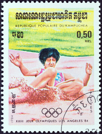 kampuchea: KAMPUCHEA - CIRCA 1984: A stamp printed in Kampuchea from the \Olympic Games, Los Angeles\ 2nd issue shows long jump, circa 1984. Editorial