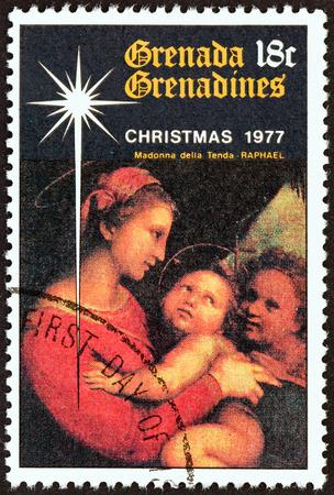 GRENADINES OF GRENADA - CIRCA 1977: A stamp printed in Grenada from the \\\Christmas \\\ issue shows Madonna della Tenda (Raphael), circa 1977. Editorial