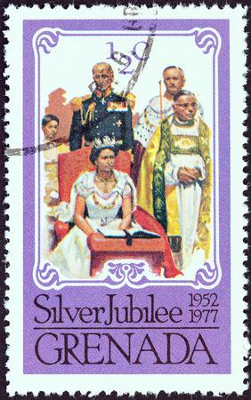 coronation: GRENADA - CIRCA 1977: A stamp printed in Grenada issued for the Coronation of Queen Elizabeth II, 25th anniversary shows Coronation, circa 1977.