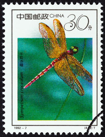chinese postage stamp: CHINA - CIRCA 1992: A stamp printed in China from the \19th International Entomology Congress, Beijing - Insects \ issue shows Dragonfly (Sympetrum croceolum), circa 1992.