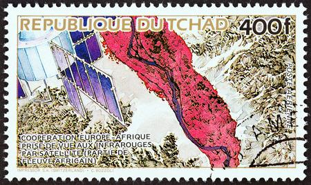 sello: CHAD - CIRCA 1984: A stamp printed in Chad shows Satellite and Satellite photo, circa 1984.