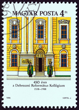 magyar posta: HUNGARY - CIRCA 1988: A stamp printed in Hungary issued for the 450th anniversary of Debrecen Calvinist College shows the facade, circa 1988. Editorial