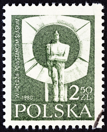 polska monument: POLAND - CIRCA 1981: A stamp printed in Poland issued for the 60th anniversary of the Silesian Uprisings shows Honour to the Silesian Rebels (statue by Jan Borowczak), circa 1981.