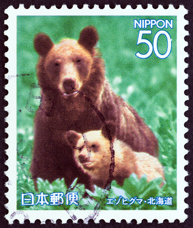 ussuri: JAPAN - CIRCA 2006: A stamp printed in Japan from the Prefectural Stamps - Hokkaido - Northern Animals  issue shows Ussuri brown bear (Ursus arctos yesoensis), circa 2006. Editorial