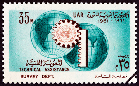 technical department: EGYPT - CIRCA 1961: A stamp printed in Egypt issued for the UN Technical Assistance Program and 16th anniversary of the UN shows Globe and Cogwheel, circa 1961.