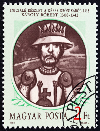 chronicle: HUNGARY - CIRCA 1988: A stamp printed in Hungary from the Hungarian Kings  2nd issue shows Karoly I (Charles Robert), detail of decorated initial from Illuminated Chronicle, 1358, circa 1988. Editorial