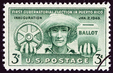 puerto rican: USA - CIRCA 1949: A stamp printed in USA issued for the 1st Gubernatorial Election in Puerto Rico shows Puerto Rican, Cogwheel and Ballot Box, circa 1949. Editorial