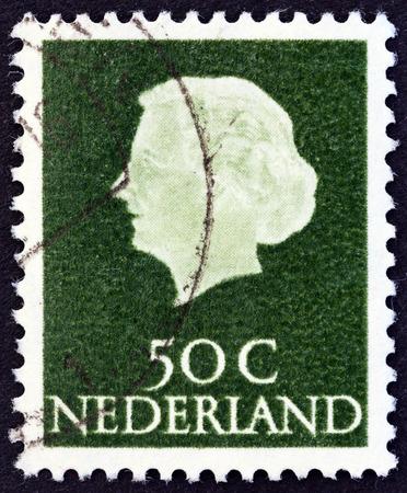 orange nassau: NETHERLANDS - CIRCA 1953: A stamp printed in the Netherlands shows Queen Juliana, circa 1953. Editorial