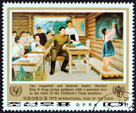 il: NORTH KOREA - CIRCA 1979: A stamp printed in North Korea from the International Year of the Child issue shows Kim Il Sung and childrens corps members in classroom, circa 1979. Editorial