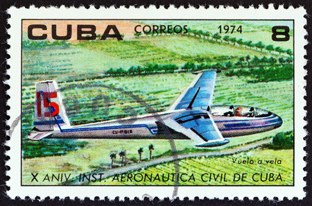 aeronautical: CUBA - CIRCA 1974: A stamp printed in Cuba from the The 10th Anniversary of The Civil Aeronautical Institute  issue shows Glider in flight, circa 1974.