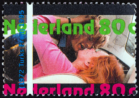 orange nassau: NETHERLANDS - CIRCA 1995: A stamp printed in the Netherlands from the Year of the Film (centenary of motion pictures)  issue shows Scene from Turkish Delight (1972), circa 1995.