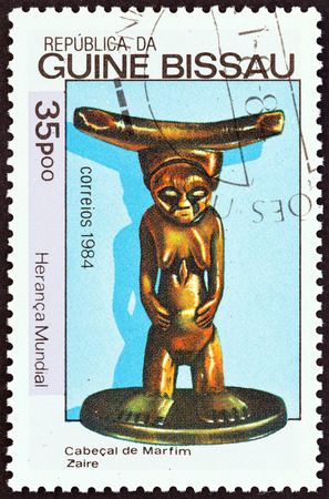 GUINEA-BISSAU - CIRCA 1984: A stamp printed in Guinea-Bissau from the World Heritage issue shows carved statuette of woman, Zaire, circa 1984.