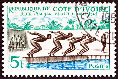 sello: IVORY COAST - CIRCA 1961: A stamp printed in Ivory Coast from the Abidjan Games issue shows swimming, circa 1961. Editorial