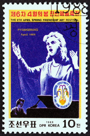 NORTH KOREA - CIRCA 1988: A stamp printed in North Korea from the 6th Spring Friendship Art Festival, Pyongyang issue shows singer (poster), circa 1988.