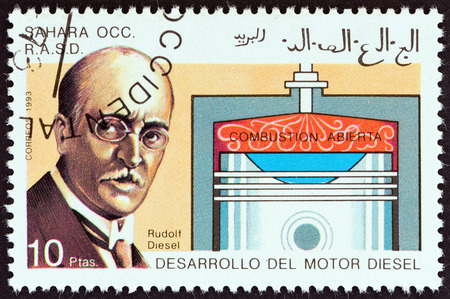 combustion chamber: WESTERN SAHARA - CIRCA 1993: A stamp printed in Western Sahara shows Rudolf Diesel and open combustion chamber, circa 1993. Editorial